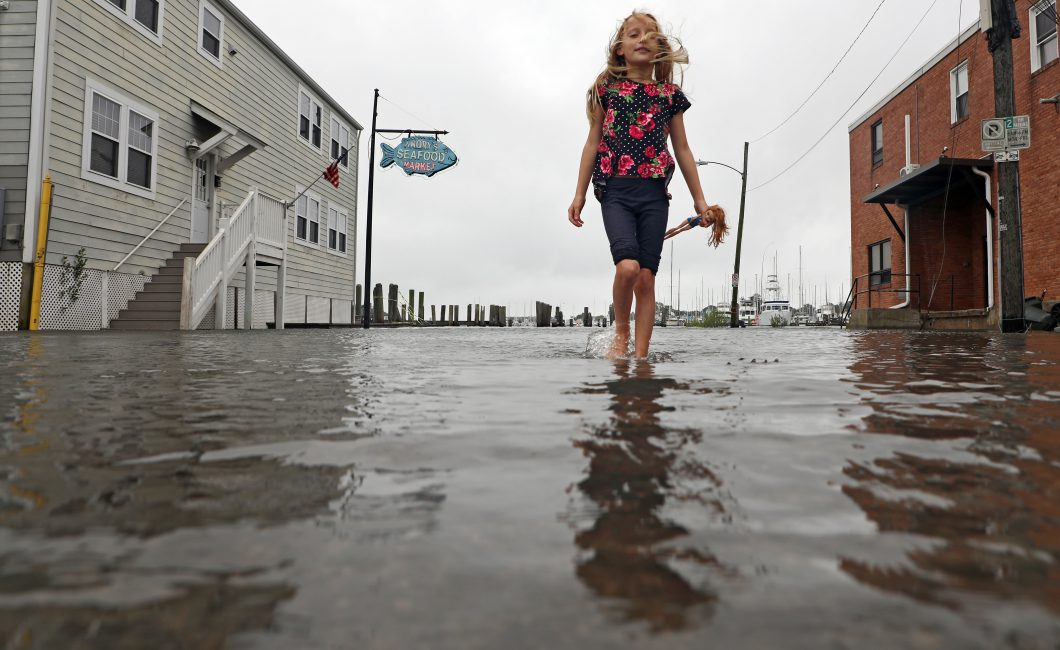 Dayja Weeks, 9, walks through the flooded streets due to Hurricane Florence near the Seafood Armory in Hampton Roads, Virginia.